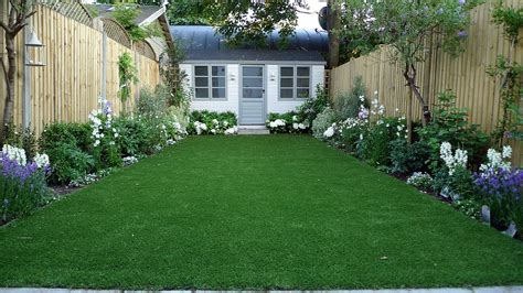 house lawn design artificial easy grass lawn summer house sandstone paving and white flower planting