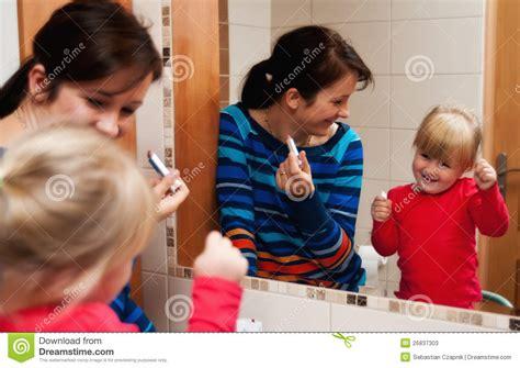 mirrors 2 bathroom scene bathroom mirror family scene stock photos image 26837303