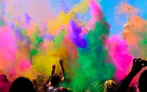 colors of holi festival spread into air wallpaper