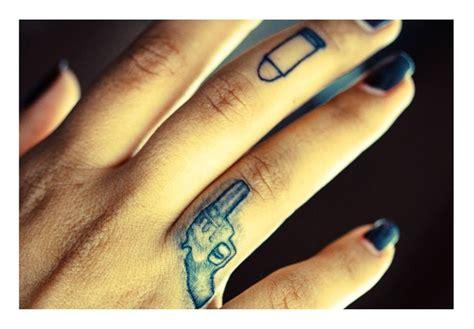 tattoo on trigger finger finger tattoo gun bullet tattoos pinterest bullets