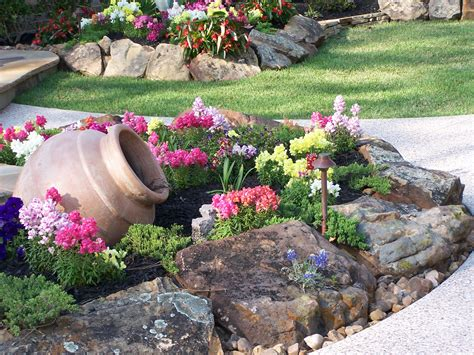 flowers for rock gardens adorable rock garden design with clay jar and colorful