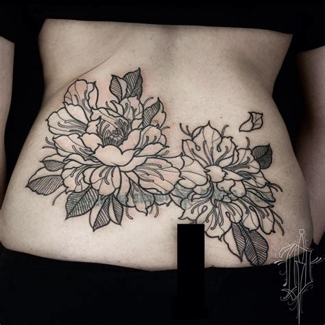 flower back tattoos 50 gorgeous lower back tattoos that look