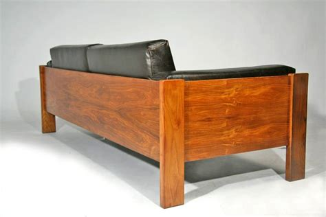 solid caviuna wood frame leather sofa at 1stdibs