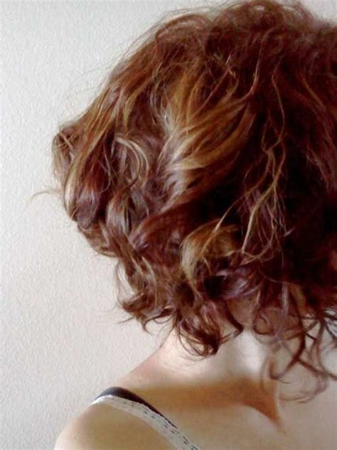 sideview of long wavy angled bob side view of chic highlighted short curly hairstyle