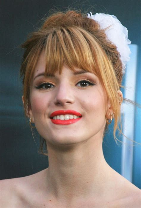 bella thorne s top knot hairstyle hair swept up into a