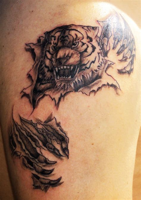 tiger cross tattoo ripped skin 3d tiger on shoulder cool tattoos