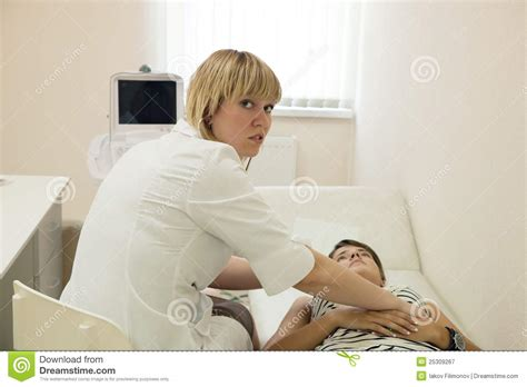 doctor examining woman woman doctor examining the patient royalty free stock