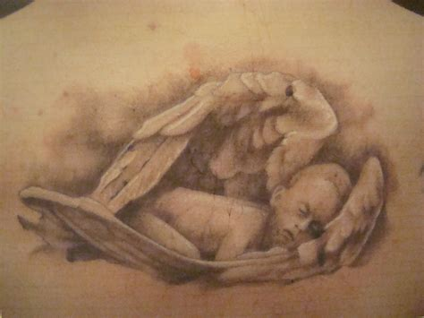 sleep tattoo sleeping cherub on back