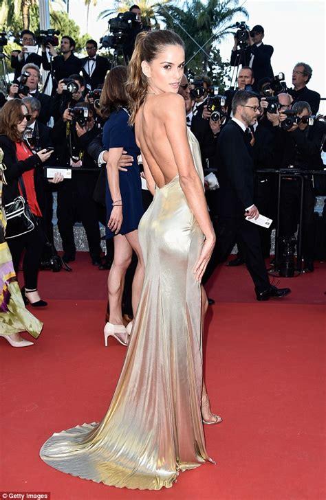 izabel goulart displays legs in metallic dress