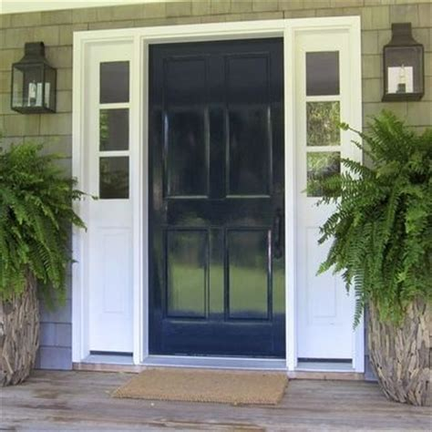 navy blue door navy blue door and shutters khaki and white house