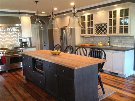 dark grey island with white countertop and antique white white cabinets with dark grey quartz counter dark grey or