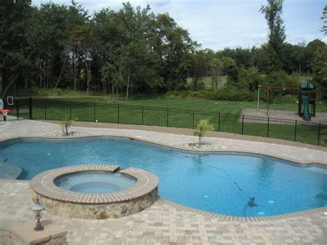 splash pool ideas this beautiful freeform in ground pool features a spa