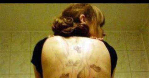 tattoo back turd angry ex boyfriend tattoos a pile of poop on girlfriend s