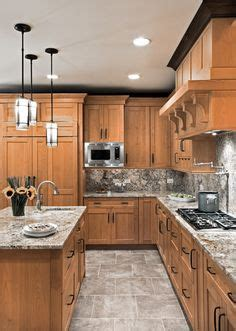 how to stagger existing cabinets cherry cabinets greenish black soapstone counters and