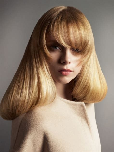 hair with a billowing inward turn and curved tapered bangs