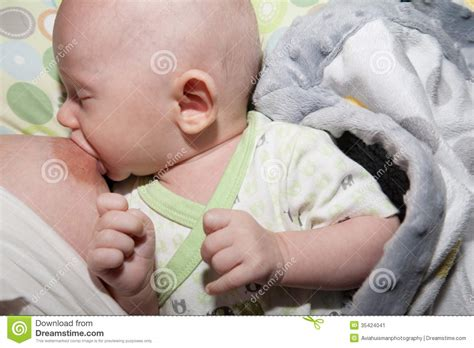how to tell if baby is comfort nursing breastfeeding baby boy stock image image 35424041