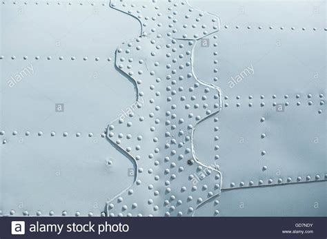 7 Ways To Cope With Airplane Skin by Texture Light Skin Of The Aircraft With Rivets Stock Photo