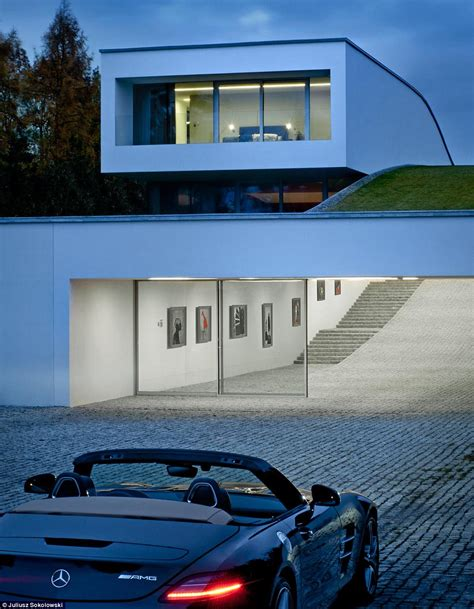 futuristic home features a drive thru gallery daily