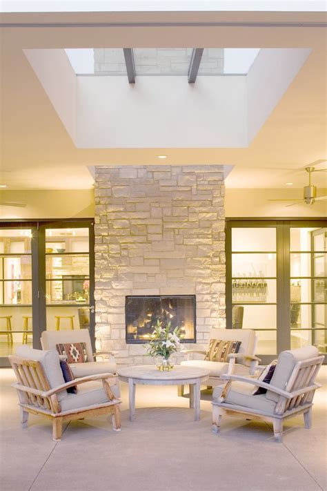 double sided fireplace indoor outdoor Bedroom Contemporary with bookcase bookshelves built in