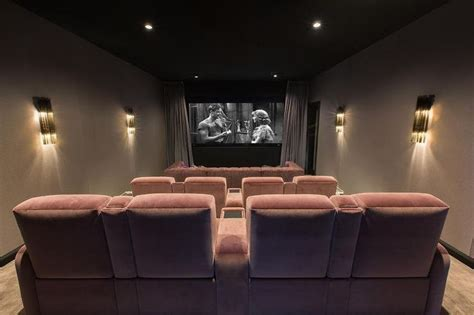 theatre room lounges deco style room features theatre seating composed of pink velvet lounge chairs and a