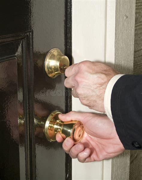 unlock door key download man driver unlocking or locking unlock the door stock photo image of lock knob door