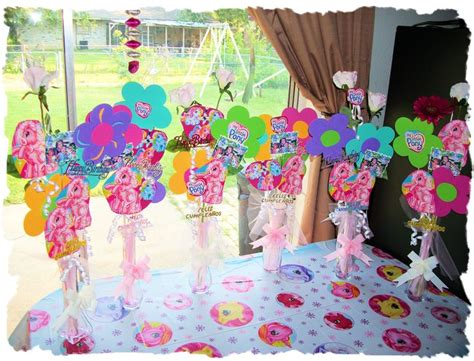 pony table decorations with pictures of birthday