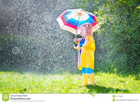 raincoat with umbrella toddler with umbrella in the stock photo image 41770200