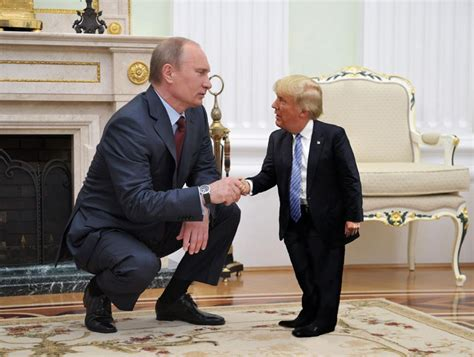 donald trump holding little boy tiny trump is what the world needs right now 171 twistedsifter