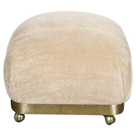 pouf or ottoman mid century modernist stylized ottoman or pouf with