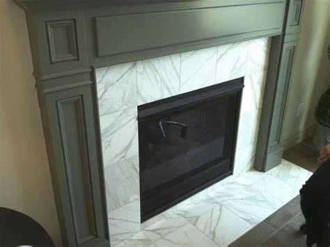 carrara white tile fireplace surround found at contempo
