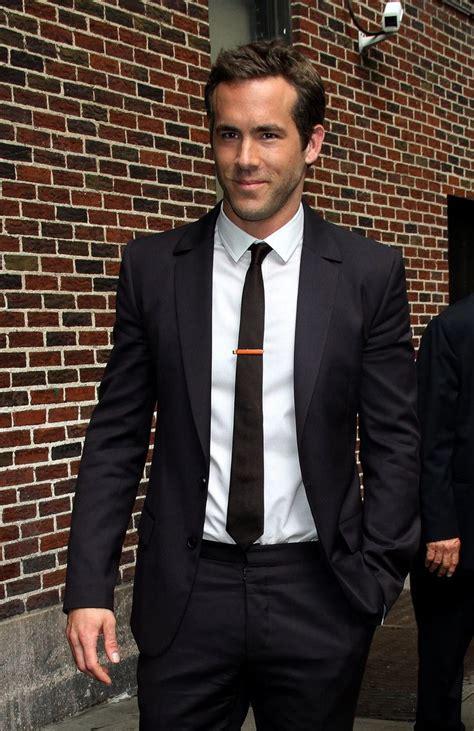 black suit white shirt black tie suit up