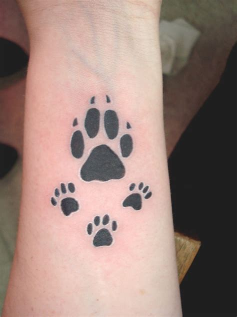 paw print tattoo by leelab on deviantart