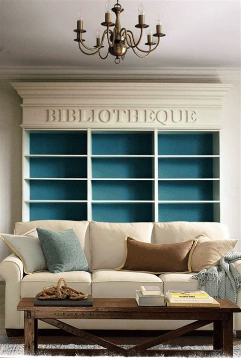 contrasting paint colors enhance the interior of bookcases sea green designs llc