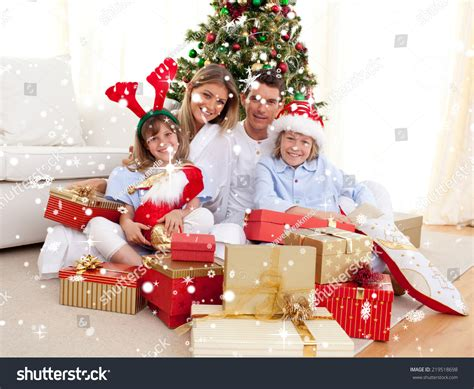 composite image happy family holding christmas stock photo