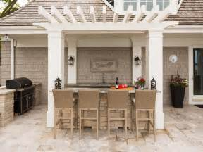 cottage style setup a bar is a common feature of outdoor kitchens created by southview design