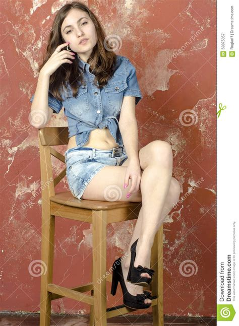 young girl models shorts cheerful young teen girl in denim shorts stock image