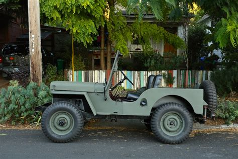 army jeep parked cars 1949 willys cj 2a army jeep
