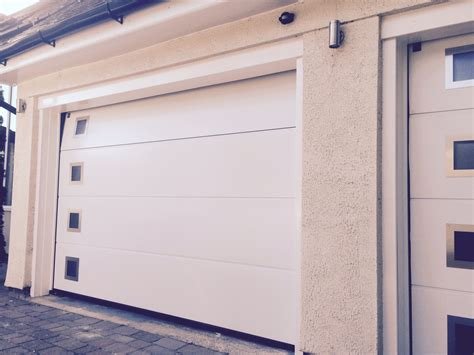 Installing Sectional Garage Door by Sectional Garage Doors Manchester Sectional Garage Doors