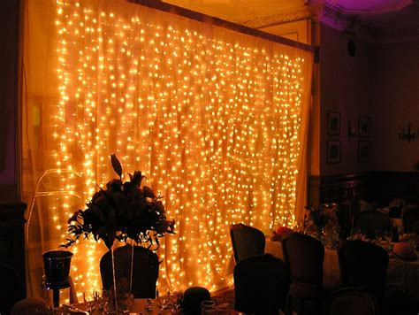 fairy curtain lights fairy light curtain behind the band reception decoration