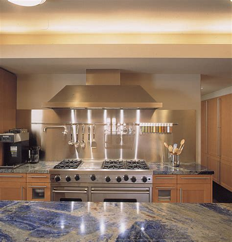 kitchen backdrop stainless steel backdrop in a kitchen with blue countertops