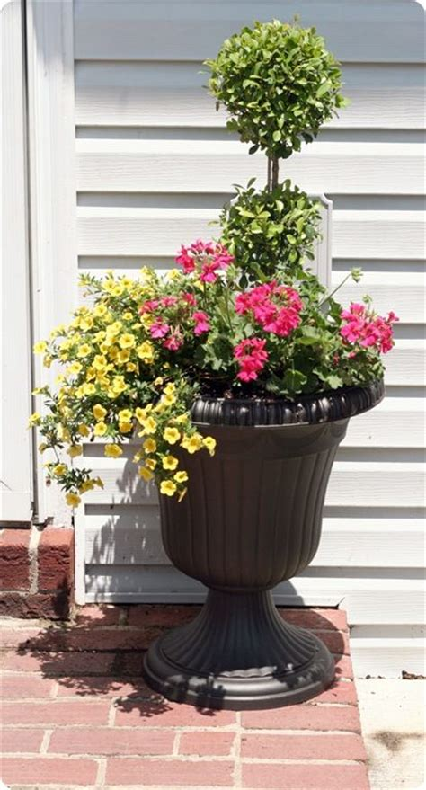 urns by the front door new house decorating ideas