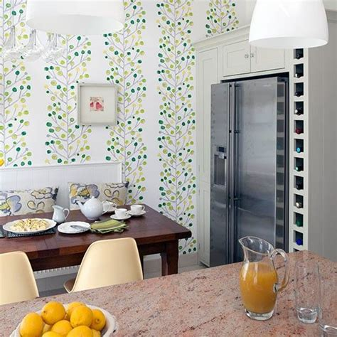 kitchen diner with green feature wallpaper kitchen