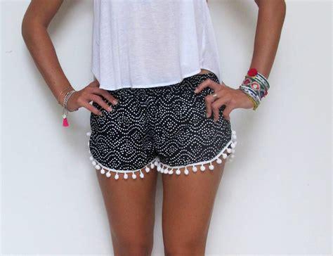 white patterned shorts pom pom shorts black and white dot pattern with white pom