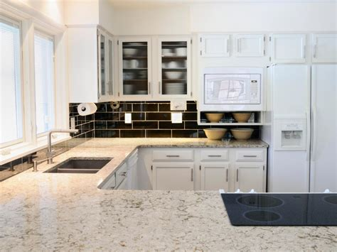 best countertops for white kitchen cabinets white granite countertops hgtv