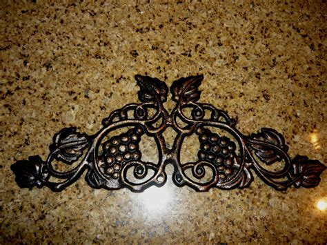 grapevine wall decor 13 inches cast iron grapevine topper wall plaque valance