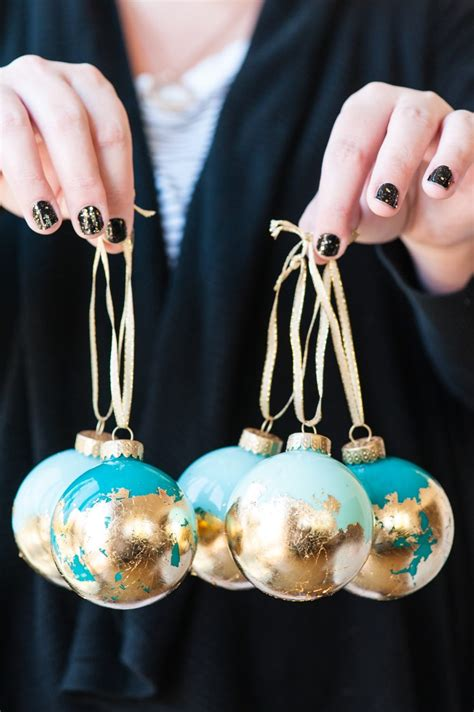 why do we put ornaments on out tree diy painted gold leaf ornaments the sweetest occasion