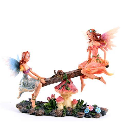 fate e fiori statua statuina fata fatina dei fiori su altalena in resina