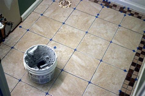 installing tile floor in bathroom how to install bathroom floor tile how tos diy