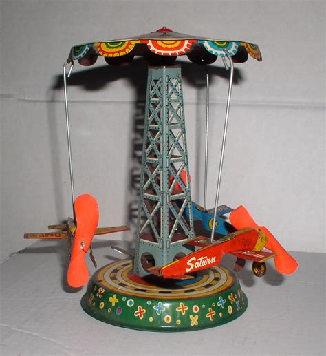 rubber st carousel asahi three airplane wind up carousel japan tin works