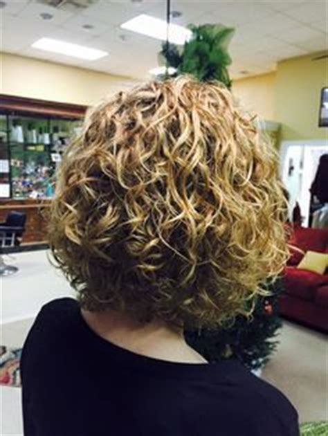 short layered hair wit loose perm perms for medium length hair spiral perm hairstyles on